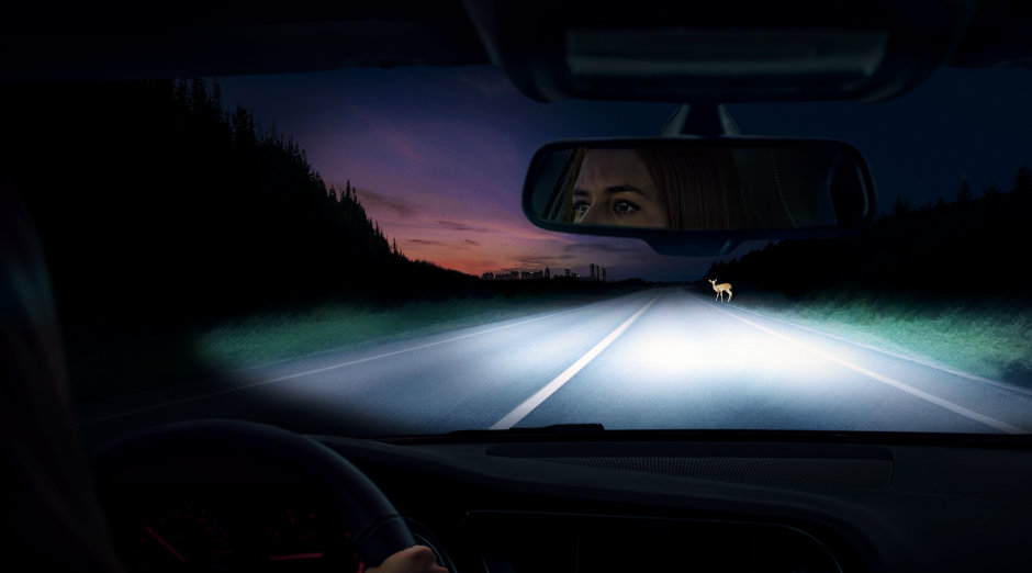Woman drives at dawn in car with NIGHT BREAKER 200 lamps